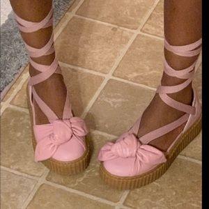 Pink strap up pumas